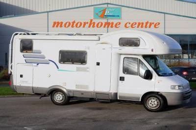 2000 Hymer Camp 524|Hymer double dinette|Large rear garage|Bunk Beds|Dinetter and double bed|Bottom bunks lifts for storage|Front to rear habitation|Washroom and shower|Rear to front habitation|Hymer Camp External|